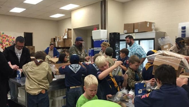 Twenty-five Cub Scouts donated time to The Kitchen's Meals on Wheels program by preparing 1,540 shelf stable meals on Wednesday, Nov. 21, 2017.