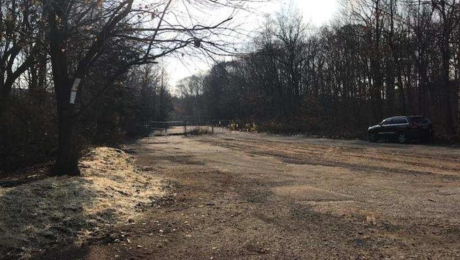 The entrance to the former Warner Bros. theme park in West Milford was cleared of its former archway on Dec. 4, as state officials seek to expand the parking area for the trail-threaded park.