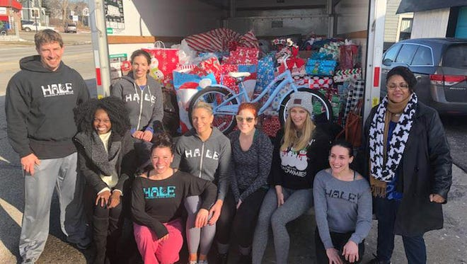 HALE Strength and Shape owners and employees, joined by Ennis Center for Children representatives, filled up a U-Haul truck with gifts for foster children.