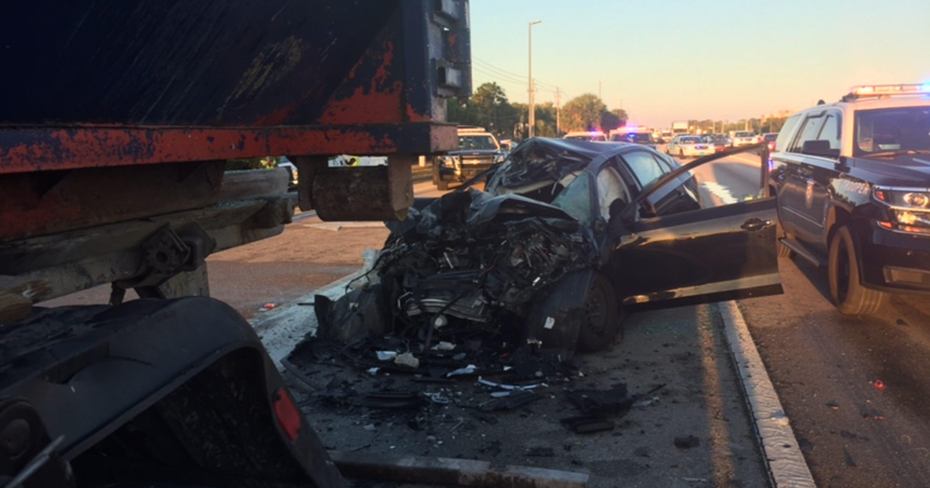 fatal car truck crash closes  daniels parkway