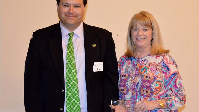 Dr. Barrett Bryant (left), Chair of the University of North Texas' Department of Computer Science and Engineering, recently presented Ranette Halverson, Chair of the Department of Computer Science at Midwestern State University, with a Lifetime Achievement Award. Halverson earned her doctorate from UNT and her bachelor's and master's degrees from MSU Texas.