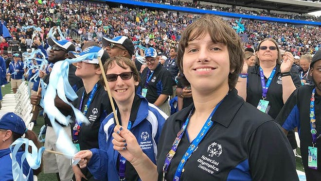 Jillian Mathews, a Special Olympics athlete from Felton, waves a ribbon during the opening ceremony of the USA Games on July 1 in Seattle. The Kent Wild Cats runner won a silver medal in the 4x100-meter relay, a bronze in the the 800-meter and was in the top 10 in two other events.