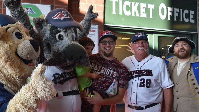 Dan Heitkamp was honored as the Somerset Patriots 7,000,000 fan on July 26. He is pictured with his 4 year old godson, Logan