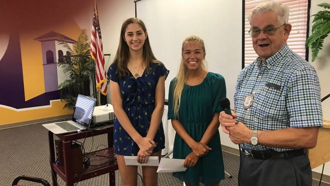 Gabriela O'Keefe, left, and Marley Williams received scholarship from Peter Falley, treasurer of the Silver City Rotary Foundation.