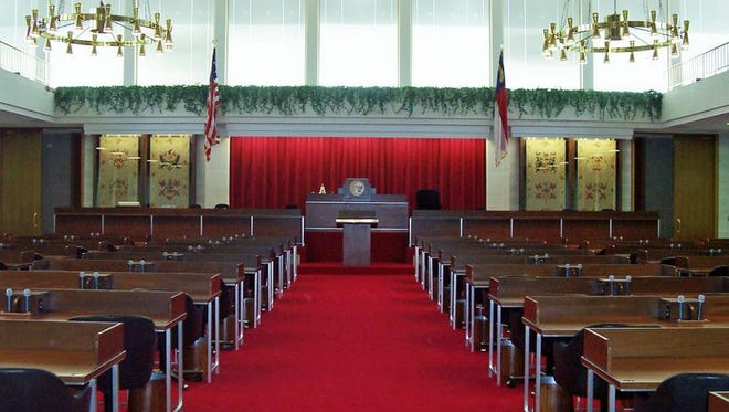The House chamber in the state Legislative Building in Raleigh. The speaker's rostrum is in the center, in front of the red curtain.