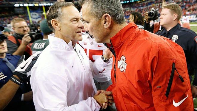Michigan State coach Mark Dantonio and Ohio State coach Urban Meyer.