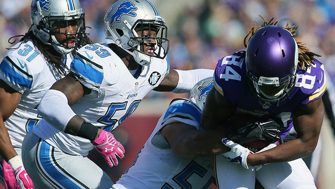 Vikings WR Cordarrelle Patterson runs the ball against the Lions during Sunday's game in Minneapolis.
