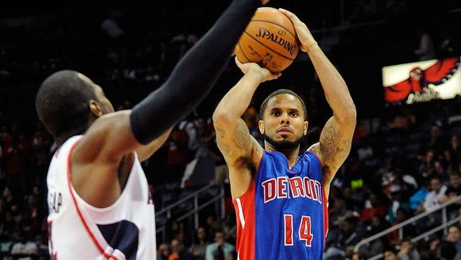 Pistons guard D.J. Augustin shoots against Hawks forward Paul Millsap during the second half of the Pistons' 104-100 exhibition win Saturday in Atlanta.