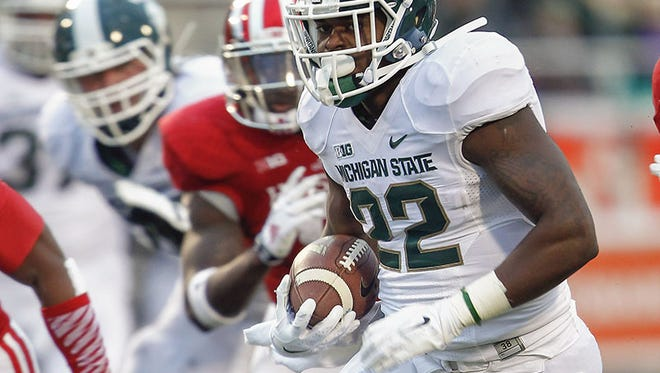 Michigan State's Paul Andrie runs the ball for an eventual touchdown Saturday against Indiana.