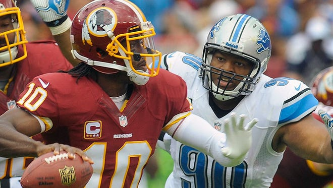 Lions DT Ndamukong Suh chases Redskins QB Robert Griffin III on Sept. 22, 2013.