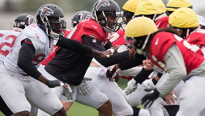 The Falcons practice in London Colney, England, on Wednesday.