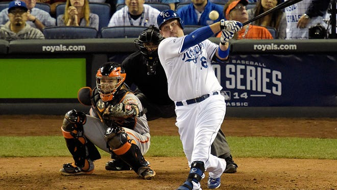 Royals designated hitter Billy Butler (16) hits a RBI single against the San Francisco Giants in the sixth inning during fame two of the 2014 World Series at Kauffman Stadium. Mandatory Credit: