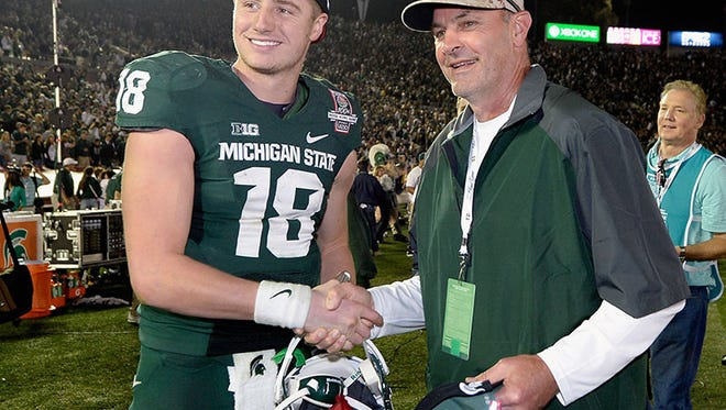Michigan State QB Connor Cook and former WR and Detroit Tigers legend Kirk Gibson after the win at the Rose Bowl on Jan. 1.