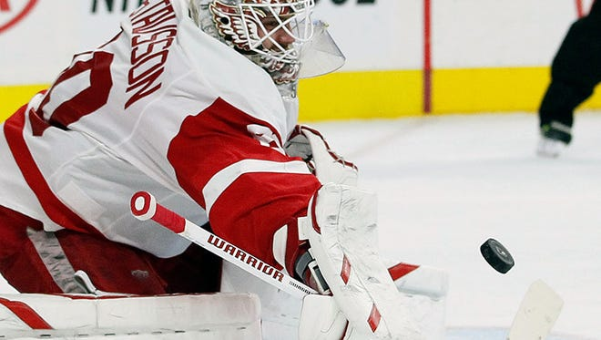 Red Wings goalie Jonas Gustavsson turns away a shot on goal in the second period of the Wings' 4-2 loss Saturday in Philadelphia.