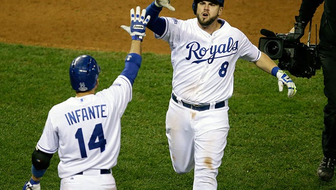 Royals third baseman Mike Moustakas is congratulated  by second baseman Omar Infante after hitting a home run during the seventh inning of Game 6 of the World Series Tuesday in Kansas City, Mo.