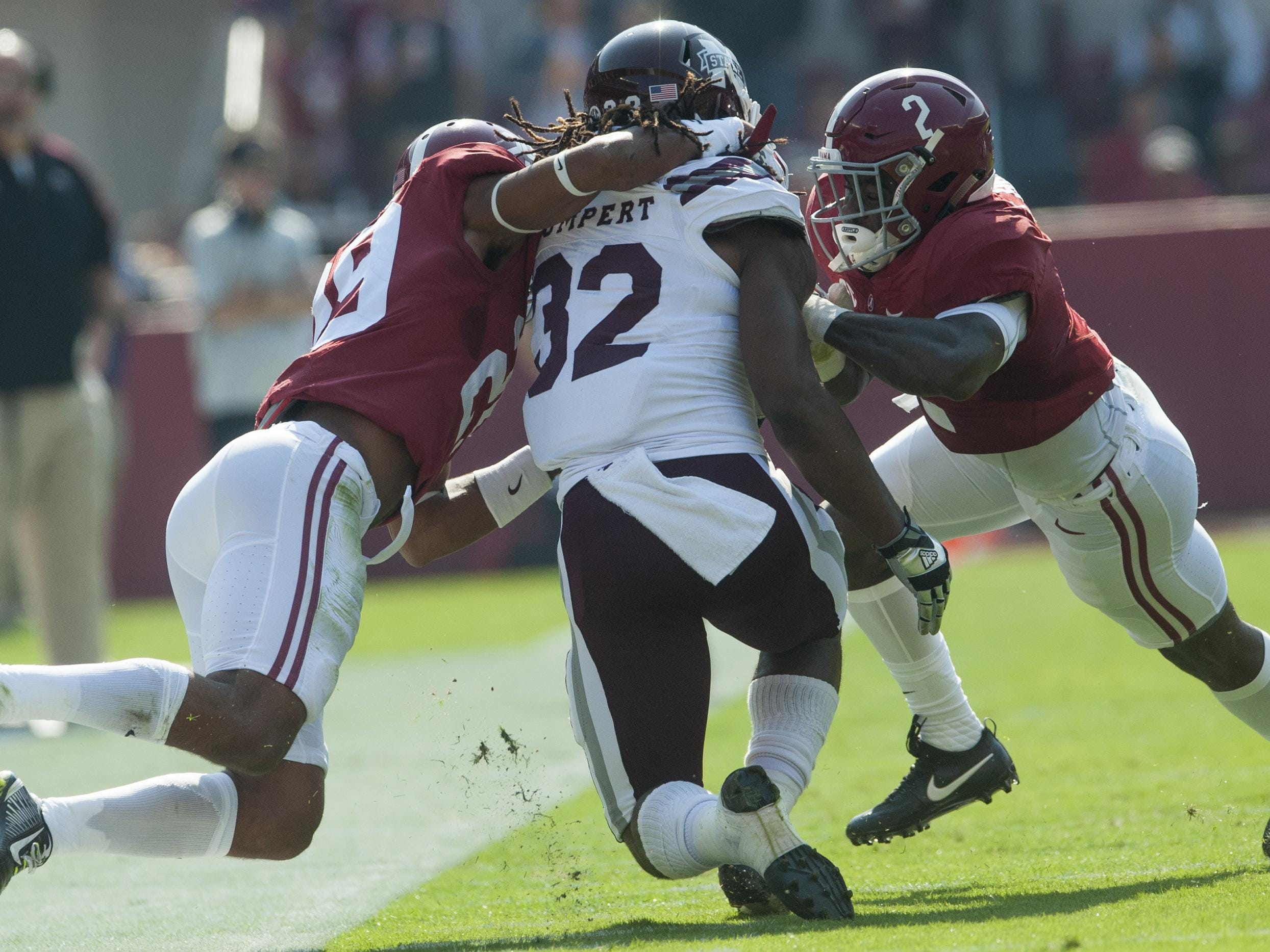 Alabama defensive back Minkah Fitzpatrick (29) and defensive back Tony Brown (2) stop Mississippi State running back Ashton Shumpert (32) at Bryant Denny Stadium in Tuscaloosa, Ala. on Saturday November 12, 2016. (Mickey Welsh / Montgomery Advertiser)