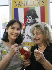Ann Johnson, left, owner of the French Unicorn, poses with Linda Aiello-Shaw for the opening of Napoleon's, the crepe and gelato shop formerly in the Reed Opera House. The two will reopen the shop at the French Unicorn.