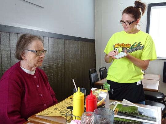 Maggie Schifer, a server at the Bucyrus Diner, takes an order Thursday from Jan Kempton of Marion, who ate at the diner with her husband, Bill.