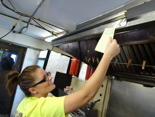 Maggie Schifer, a server at the Bucyrus Diner, places