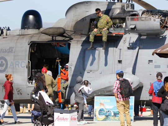 Spectators admire a Royal Canadian Air Force Sikorsky