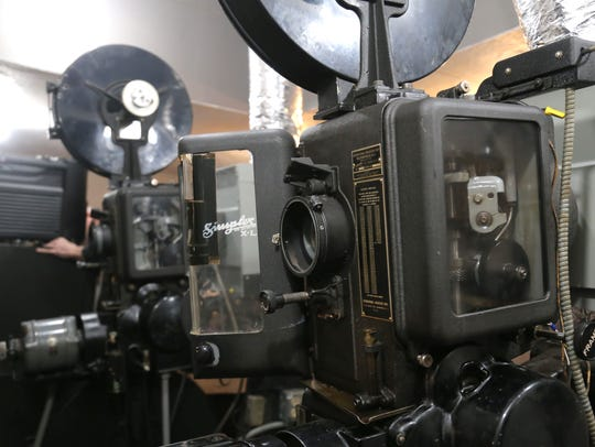 A recently refurbished film projector sits inside the