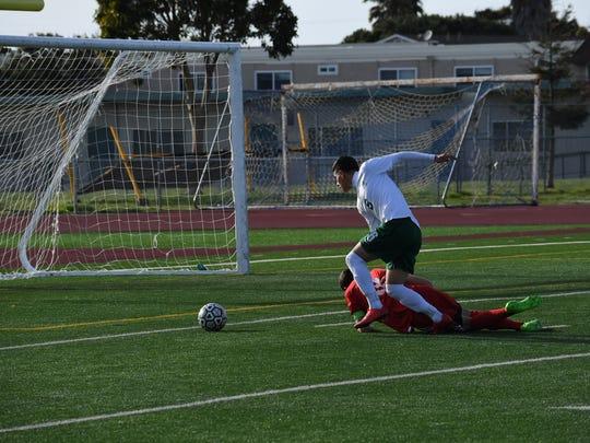 Junior forward Angel Amezcua (white) got past the defender