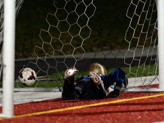 After making two saves in rapid succession, St. Cloud Apollo's goalkeeper Anna Carlson (97) watches the third ball fly past her for a goal by Sartell's Megan Sieben (5) in the first half of their Sect. 8A championship game Thursday, Oct. 22 at Husky Stadium.
