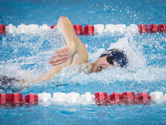 Delta's Andrew Torres competes in the 100 freestyle