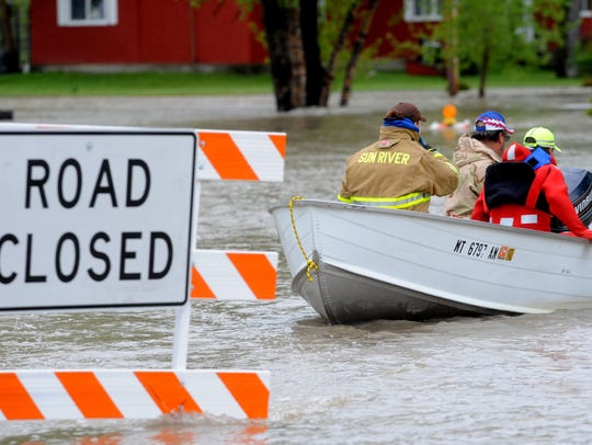 Sun River Volunteer Fire Fighters float the town of