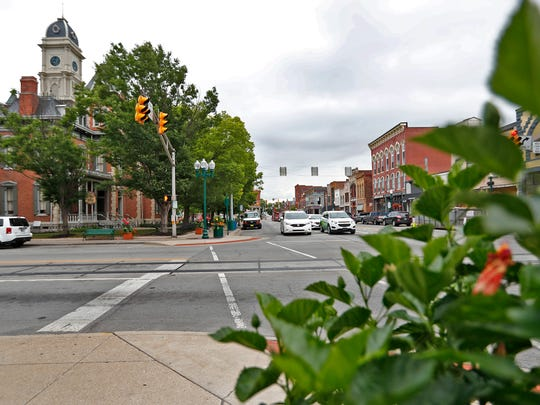 Cars move around the downtown Noblesville Square, on