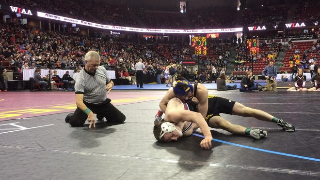 Oconto senior Elton Kelsey gets a near fall late in a 132-pound third-place match in Division 3 to win 5-4 over Spring Valley/Elmwood senior Logan Newton on Saturday at WIAA state individual wrestling tournament.