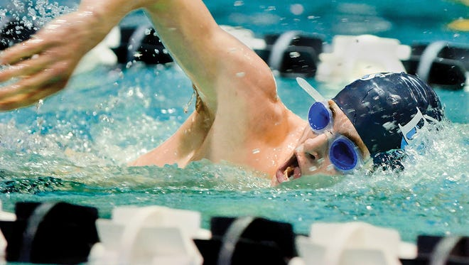 Asheville School won the Carolinas Athletic Association boys and girls swimming championships on Friday.