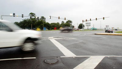 Motorists travel along U.S. 90 at its intersection with Alberston Parkway in Broussard recently. Leslie Westbrook, The Advertiser
