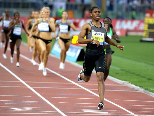 FILE - In this June 2, 2016, file photo, South Africa's Caster Semenya crosses the finish line after winning the the women's 800m event at the Golden Gala IAAF athletic meeting, in Rome's Olympic stadium. It seems the sports world just doesn't know what to do with an athlete like Semenya. The South African runner, and others like her, may present one of the greatest dilemmas for the perception of fairness in sports. Semenya, now 25,  is the favorite for gold at the Rio Olympics, Semenya has been pursued by gender questions. But her case has never been about a man masquerading as a woman.  (AP Photo/Gregorio Borgia, File)