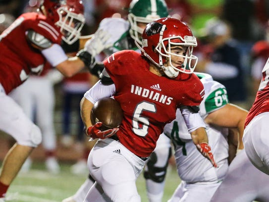 Jim Ned's Riley Perry runs the ball against Wall during