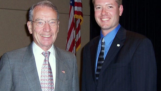 Aaron McKay with U.S. Sen. Chuck Grassley. McKay has been appointed Grassley's new state office director
