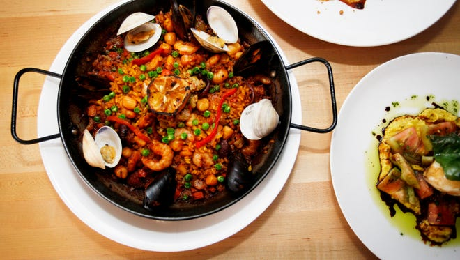 Rezaz's paella, a flavorful bomba rice cooked with saffron swam with peas, roasted red pepper and copious amounts of clams, mussels, shrimp and scallops.