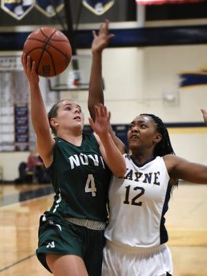 Novi's Jessie Bandyk (left) puts up a shot over the hand of Wayne's Jayah Hicks.