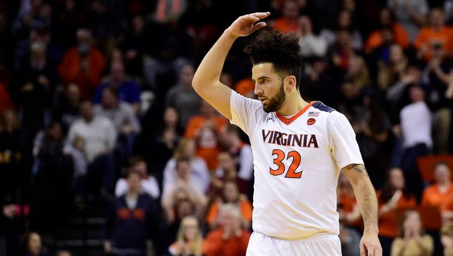 Virginia guard London Perrantes (32) reacts after in a play in the second half against Wake Forest.
