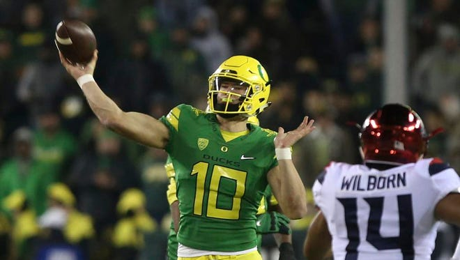 Oregon's quarterback Justin Herbert throws down field against Arizona during the second quarter of an NCAA college football game Saturday, Nov. 18, 2017, in Eugene, Ore. (AP Photo/Chris Pietsch)