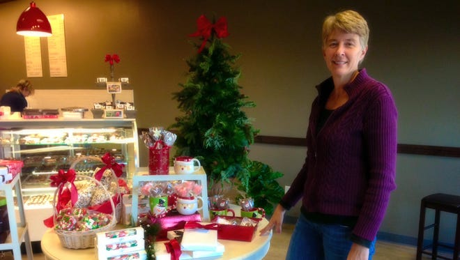 West High graduate Cindy Riley opened Winans Fine Chocolates and Coffees in Coralville on Nov. 1.