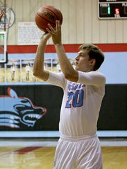 Hirschi's Pietro Lazzarotto puts up a shot during the