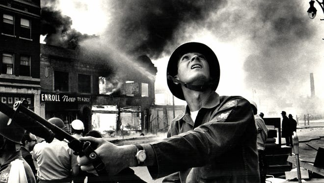 National Guardsman Gary Ciko checks on buildings for snipers on the first day of the 1967 riot in Detroit, Michigan.
