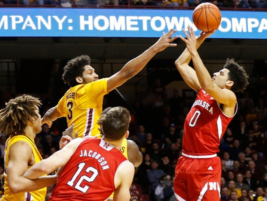 Nebraska's Tai Webster, right, of New Zealand, shoots as Minnesota's Jordan Murphy defends during the first half of an NCAA college basketball game Thursday, March 2, 2017, in Minneapolis. (AP Photo/Jim Mone)
