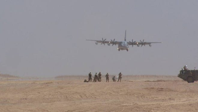 A C-130 cargo plane from the 120th Airlift Wing of the Montana Air National Guard lands on an assault landing strip built by the 809th Expeditionary Squadron in Afghanistan. Neighbors near Malmstrom area concerned about what impact a potential training landing strip for the aircraft could have on property values.