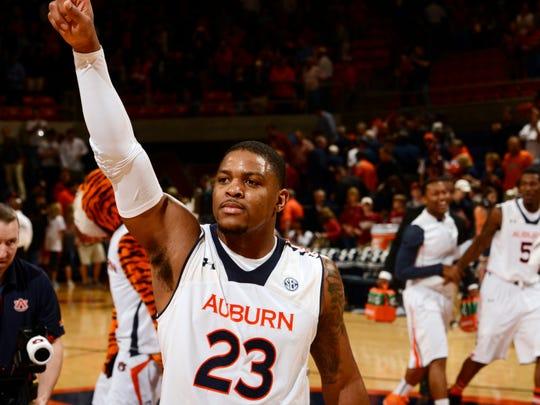 Auburn's Frankie Sullivan waves to teh crowd after Auburn beat Alabama 49-37. Alabama vs Auburn mens basketball on Wednesday, Feb. 6, 2013 in Auburn, Ala.