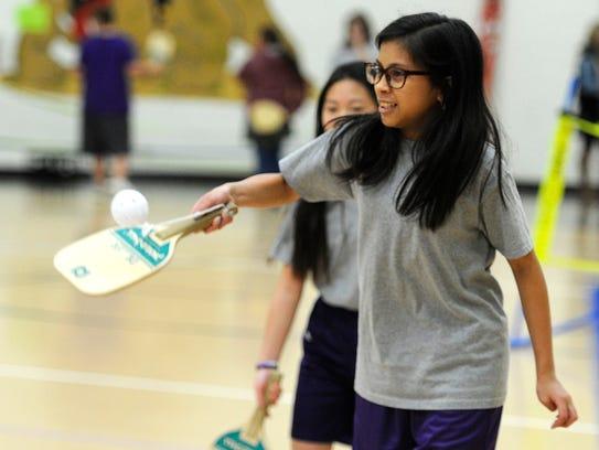 Caliegh Ann Enriquez returns a ball while playing pickleball