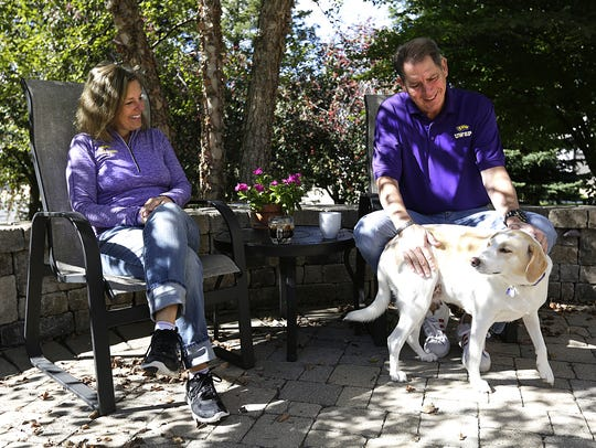 Rhonda and Rob Sutherland of West Bend play with their