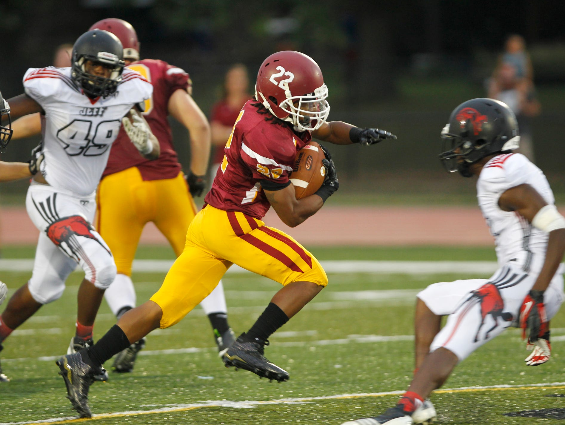 McCutcheon's Levon Thompson shoots through the Lafayette Jeff defense on a 66 yard touchdown run at 9:18 in the second quarter Friday, September 4, 2015, at Scheumann Stadium. McCutcheon beat Lafayette Jeff 38-20.
