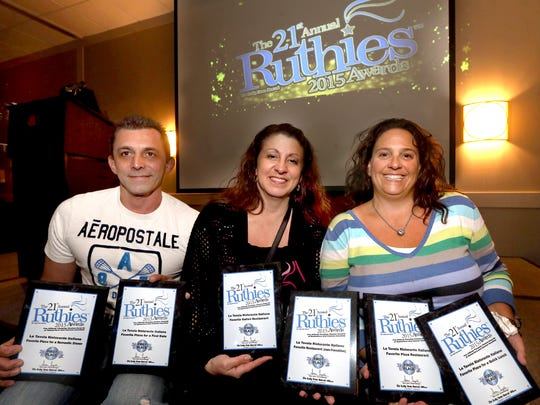 From,  Massimo Esposito, Linda Esposito, and Nicole Ward hold the six different first-place Ruthie Awards that the Esposito's resturant, LaTavola Ristorante Italiano, won Thursday, Oct. 22, 2015.